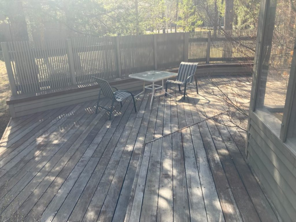 Before photo of a deck prior to Randy refinishing